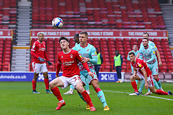 Joe Lolley of Nottingham Forest watches the ball, pressured by Viktor Gyokeres of Swansea City  - Mandatory by-line: Nick Browning/JMP - 29/11/2020 - FOOTBALL - The City Ground - Nottingham, England - Nottingham Forest v Swansea City - Sky Bet Championship