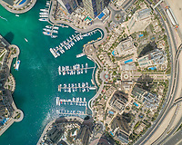 Aerial view of Dubai Marina with moored boats and skyscrapers, UAE.