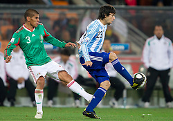 Carlos Salcido of Mexico vs Javier Pastore of Argentina during the 2010 FIFA World Cup South Africa Round of Sixteen match between Argentina and Mexico at Soccer City Stadium on June 27, 2010 in Johannesburg, South Africa. Argentina defeated Mexico 3-1 and qualified for quarterfinals. (Photo by Vid Ponikvar / Sportida)