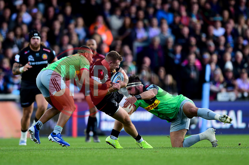Sam Simmonds of Exeter Chiefs is tackled by Scott Baldwin of Harlequins and Joe Marchant of Harlequins  - Mandatory by-line: Ryan Hiscott/JMP - 19/10/2019 - RUGBY - Sandy Park - Exeter, England - Exeter Chiefs v Harlequins - Gallagher Premiership Rugby
