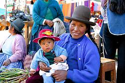 Woman & Child At Pisco Market