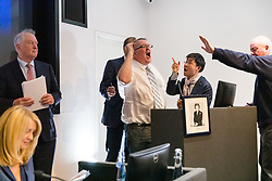 """© Licensed to London News Pictures. 10/06/2019. London, UK.  A heckler takes over the podium after Tory leadership candidate, Esther McVey made a pro Brexit speech about """"Taking Back Control of Britain's EU Exit"""" at a Bruges Group event held in Westminster. Many of the Tory leadership candidates are holding launch events in the capital today. Photo credit: Vickie Flores/LNP"""