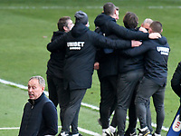 Football - 2020 / 2021 Sky Bet Championship - Swansea City vs Preston North End - Liberty Stadium<br /> <br /> Swansea Manager Steve Cooper   talks to his bench on the touchline after Matt Grimes Swansea City concedes an own goal in the 90th minute, Preston staff celebrate in background<br /> <br /> COLORSPORT/WINSTON BYNORTH