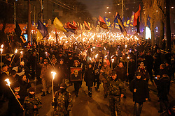 January 1, 2018 - Kiev, Ukraine - Supporters and members of different far right nationalistic movements and parties participate an annual torch march downtown Kyiv confined to the 109th birthday of Ukrainian nationalism ideologist and insurgent army commander Stepan Bandera, Kyiv, Ukraine, Jan.1, 2018. (Credit Image: © Sergii Kharchenko/NurPhoto via ZUMA Press)