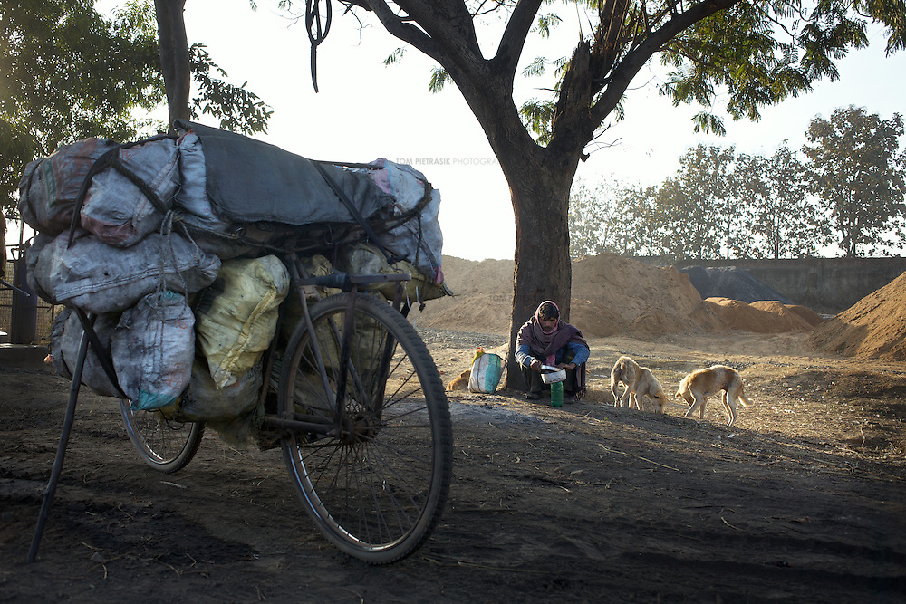 Men carry coke on bicycles 25km from the illegal mine of Parwadhi Punkharee to the  district town of Hazaribagh. This coke is for household consumption and the carrier can expect to make INR.300-500 per journey. Most choose to hire a tractor to ferry them and their loads up the steep hill at the beginning of the journey. ..Photo: Tom Pietrasik.Jharkhand, India.January 28th 2010