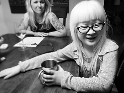 Lotus Hoben with with her mother, photographer Stephanie Sinclair, while social distancing at home during the pandemic. Forest and Lotus Hoben, ages 10 and 6, were adopted from China and have albinism, a rare group of genetic disorders that cause the skin, hair, or eyes to have little or no color. Albinism is also associated with vision problems. According to the National Organization for Albinism and Hypopigmentation, about 1 in 18,000 to 20,000 people in the United States have a form of albinism.