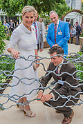 HRH the Countess of Wessex with the gate designer,  patron of the charity, on Blind Veterans UK: its all about Community Garden by Andrew Fisher Tomlin and Dan Bowyer - The Hampton Court Flower Show, organised by the Royal Horticultural Society (RHS). In the grounds of the Hampton Court Palace, London.