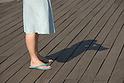woman standing on a wooden boardwalk