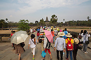 Many tourists walk along the walkway to towards the ancient Angkor Wat temple, Siem Reap, Cambodia.  Angkor Wat is one of UNESCO's world heritage sites. It was built in the 12th century and covers 162 hectares.  It is Cambodia's main tourist attraction.  (photo by Andrew Aitchison / In pictures via Getty Images)