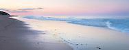 A peaceful sunset with murmuring surf at Cahoon Hollow Beach in Wellfleet