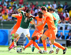 29.06.2014, Castelao, Fortaleza, BRA, FIFA WM, Niederlande vs Mexico, Achtelfinale, im Bild Oribe Peralta (Mexiko) gegen Georginio Wijnaldum (Niederlande), Stefan de Vrij (Niederlande), Andres Guardado (Mexiko) // during last sixteen match between Netherlands and Mexico of the FIFA Worldcup Brazil 2014 at the Castelao in Fortaleza, Brazil on 2014/06/29. EXPA Pictures © 2014, PhotoCredit: EXPA/ fotogloria/ Best Photo Agency<br /> <br /> *****ATTENTION - for AUT, FRA, POL, SLO, CRO, SRB, BIH, MAZ only*****