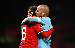 Manchester United's Juan Mata (left) embraces Manchester City's David Silva (right) after the final whistle
