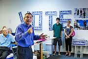 "02 JUNE 2012 - PHOENIX, AZ:   Congressman DAVID SCHWEIKERT (R-AZ) talks to campaign volunteers Saturday in front of a sign that says ""vote."" Schweikert met with his campaign staff and volunteers for a pancake breakfast Saturday morning at the campaign headquarters to talk to them about the upcoming primary election against fellow Republican Ben Quayle. Republican incumbents Schweikert and Quayle will face each other in Arizona's Aug. 28 primary election. Redistricting because of the census has thrown the two conservative freshman Republican Congressmen into Arizona's 6th Congressional District. The district is made up of mostly upper middle class neighborhoods in north Phoenix and the wealthy suburban communities of Scottsdale, Fountain Hills and Cave Creek. The District is strongly Republican and whoever wins the Republican primary is expected to easily win November's general election.       PHOTO BY JACK KURTZ"