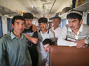 They met on the train. A mix of uighur students and workers return back to Kashgar after spending time in Hotan for work. Train is the cheapest means of transportation in this part of China. It cost about 20 Yuan to travel from Hotan to Kashgar (about 4 times cheaper than bus). Life inside the train - mostly Muslim Uighur people  ride this train.