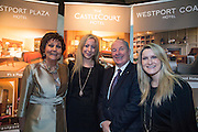 NO FEE PICTURES<br /> 23/1/16 Minister for Tourism Michael Ring and Maureen Ledwith, organiser of the Holiday World Show at the Westport Plazaand Castle Court Hotel stand at the Holiday World Show at the RDS in Dublin. Picture: Arthur Carron