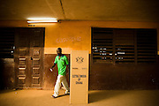 A man leaves a voting booth after filling his ballot during presidential elections in Accra, Ghana on Sunday December 28, 2008. Voters were back at the polls to decide on a new leader after none of the candidates was able to obtain a 50 percent plus one vote majority during the election's first round on Dec 7.