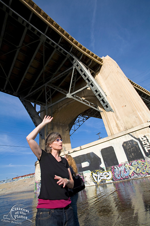From 2008. Jenny Price leads FoLAR's (Friends of the Los Angeles River) tour of the LA River, Under the 6th St Bridge, Los Angeles, California, USA