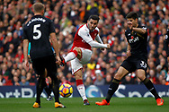 Sead Kolasinac of Arsenal's © sees his  shot  deflected off Federico Fernandez of Swansea City (R). Premier league match, Arsenal v Swansea city at the Emirates Stadium in London on Saturday 28th October 2017.<br /> pic by Steffan Bowen, Andrew Orchard sports photography.
