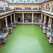 A wide-angle and elevated view of the main historic Roman Baths in Bath, Somerset.