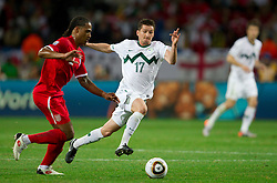 Glen Johnson of England vs Andraz Kirm of Slovenia during the 2010 FIFA World Cup South Africa Group C Third Round match between Slovenia and England on June 23, 2010 at Nelson Mandela Bay Stadium, Port Elizabeth, South Africa.  (Photo by Vid Ponikvar / Sportida)