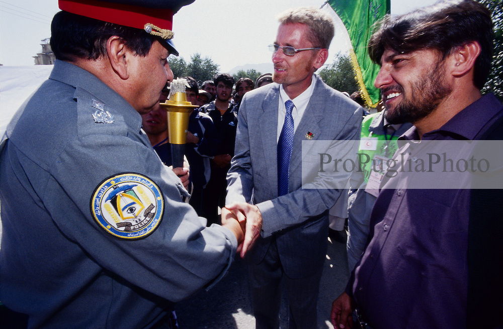 ASPECIAL OLYMPICS AFGHANISTAN..Kabul, 23 August 2005..SOA's Torch Run from Darul Aman to Ghazi Stadium...Nasurullah Izat (right) National Director of SOA, Troy W. Greisen Senior Vice President of Special Olympics International  and Haroon Asifi I.G. Police