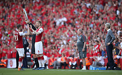 Arsenal's Calum Chambers (left) is replaced by team-mate Per Mertesacker for his final home appearance as manager Arsene Wenger (right) watches during the Premier League match at the Emirates Stadium, London.