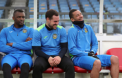 Sutton United's Craig Eastmond (right) shares a joke in the dugout during the training session at Gander Green Lane, London.