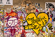 Freeman Alley, the Bowery, New York City. A yellow heart, eyelids closed, smoking either a cigarette or a blunt.