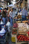 Pushing the week's worth of food in their 2-year-old son, Maurizio's stroller, Giuseppe Manzo and his wife Piera Marretta shop in Italy's Capo Market, near their apartment in Palermo, Sicily. Normally, Piera, who shops every day, would purchase this much only on special occasions. (Supporting image from the project Hungry Planet: What the World Eats.)