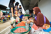 25 OCTOBER 2012 - PATTANI, PATTANI, THAILAND: A woman sells eggs and dried shrimp in the market in Pattani, Thailand.      PHOTO BY JACK KURTZ