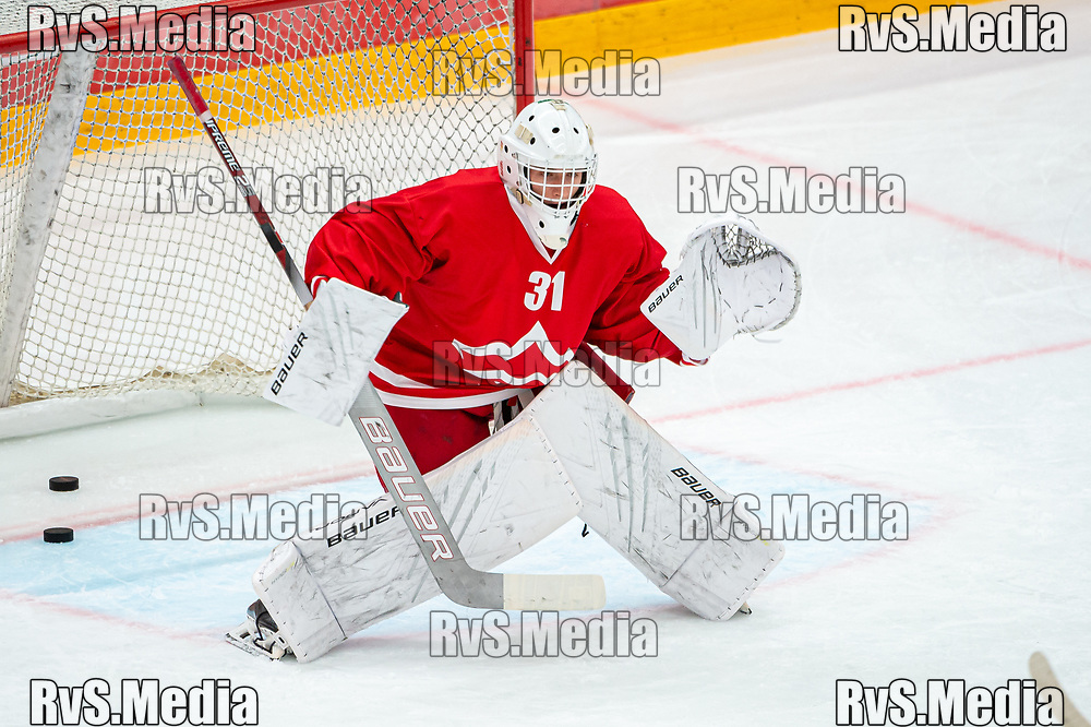 LAUSANNE, SWITZERLAND - OCTOBER 01: Goalie Loris Uberti #31 of Lausanne HC warms up prior the Swiss National League game between Lausanne HC and ZSC Lions at Vaudoise Arena on October 1, 2021 in Lausanne, Switzerland. (Photo by Robert Hradil/RvS.Media)
