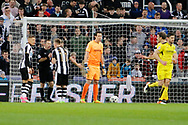 Newcastle United midfielder Matt Ritchie (11) and Newcastle United forward Dwight Gayle (9) discuss disallowed penalty with referee Keith Stroud during the EFL Sky Bet Championship match between Newcastle United and Burton Albion at St. James's Park, Newcastle, England on 5 April 2017. Photo by Richard Holmes.