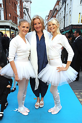 EMMA THOMPSON flanked by dancers ABIGAIL BURROWS (L) and KIMBERLEY MARREN (R) at a party to celebrate the opening of Pincess Marie-Chantal of Greece's store 'Marie-Chantal' 133A Sloane Street, London on 14th October 2008.