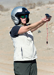 October 17, 2018 - Johnson Valley, California, U.S. - MARIA GUITAR of Team Ridgeline Rebels takes a reading on the course on Day 5 of the third annual Rebelle Rally, the first women's off-road navigation rally in the United States. The event features a unique scoring system in which precise navigation - not speed - is the ultimate goal.  With cell phones and GPS devices banned during the 10-day event, and armed with just maps, compasses and roadbooks, 43 two-person teams are tasked with scoring points based on time, distance and hidden checkpoints as they make their way across 1,600 miles of scrub brush, sand dunes and boulders in the Nevada and California desert.(Credit Image: © Brian Cahn/ZUMA Wire)