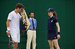 LONDON, ENGLAND - Tuesday, June 28, 2016: Aljaz Bedene (GBR) wipes his face with a Wimbledon towel as a ball girl stands by during the Gentlemen's Singles 1st Round match on day two of the Wimbledon Lawn Tennis Championships at the All England Lawn Tennis and Croquet Club. (Pic by Kirsten Holst/Propaganda)