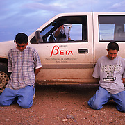 Suspects who allegedly robbed a migrant who was waiting to cross the border into the U.S., wait to be transported by Grupo Beta, the Mexican police force who oversees migrant safety. Please contact Todd Bigelow directly with your licensing requests. PLEASE CONTACT TODD BIGELOW DIRECTLY WITH YOUR LICENSING REQUEST. THANK YOU!