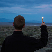 Full moon rises over the Owens Valley in the Eastern Sierras. Model released.