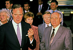 United States President George H.W. Bush, left, and President Mikhail Gorbachev of the Union of Soviet Socialist Republics, right, hold an impromptu press conference after their day of talks at Camp David, the presidential retreat near Thurmont, Maryland on Saturday, June 2, 1990. It was the conclusion of three days of talks between the two leaders. From left to right, President Bush, first lady Barbara Bush, Raisa Gorbachev, unidentified interpreter, and President Gorbachev. Photo by Ron Sachs / CNP /ABACAPRESS.COM