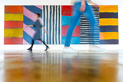 © Licensed to London News Pictures. 27/09/2018. Wakefield UK. Kerry Chase & Sam Whitworth walk past a painting By Sean Scully called Blue Note. Yorkshire Sculpture Park has unveiled a major new exhibition called Inside Outside & is the work of Sean Scully. The exhibition is the first by the Irish-born artist in the UK & is made up of Sculptures & paintings by Scully. The exhibition runs from the 29th of September until the 6th January. Photo credit: Andrew McCaren/LNP