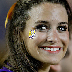 September 10, 2011; Baton Rouge, LA, USA;  A LSU Tigers cheerleader on the sideline during the second half against the Northwestern State Demons at Tiger Stadium. LSU defeat Northwestern State 49-3. Mandatory Credit: Derick E. Hingle