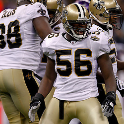 September 9, 2010; New Orleans, LA, USA;  New Orleans Saints linebacker Jo-Lonn Dunbar (56) celebrates after teammate defensive tackle Sedrick Ellis (98) recorded a sack against the Minnesota Vikings during the NFL Kickoff season opener at the Louisiana Superdome. The New Orleans Saints defeated the Minnesota Vikings 14-9.  Mandatory Credit: Derick E. Hingle
