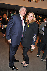 SIMON & FANELIE PHILLIPS at the launch of Samsung's NX Smart Camera at charity auction with David Bailey in aid of Marie Curie Cancer Care at the Bulgari Hotel, 171 Knightsbridge, London on 14th May 2013.