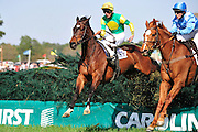 27 March 2010 : Bernie Dalton and SUNSHINE NUMBERS (left) battle over the last fence with DIVINE FORTUNE and Danielle Hodson.