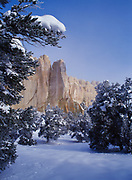 Snow-covered pinyon-juniper forest and Inscription Rock, El Morro National Monument, New Mexico.