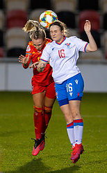 NEWPORT, WALES - Thursday, October 22, 2020: Wales' Josie Green (L) challenges for a header with Faroe Islands' Sanna Jacobsen during the UEFA Women's Euro 2022 England Qualifying Round Group C match between Wales Women and Faroe Islands Women at Rodney Parade. Wales won 4-0. (Pic by David Rawcliffe/Propaganda)