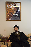 Tehran. Iran. Hassan Khomeyni in the house of his grand father. undee a portrait of the imam Khomeyni