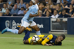 September 20, 2017 - Kansas City, Kansas, U.S - Sequence 04-02: NY Red Bulls defender Michael Amir Murillo #62 (r) falls at the sideline from a collision with Sporting KC forward Latif Blessing #9 (l) during the first half of the game. Sporting KC will win the 2017 Lamar Hunt Open Cup championship with a score of 2-1 over the New York Red Bulls. (Credit Image: © Serena S.Y. Hsu via ZUMA Wire)