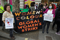 London, UK. 11th May, 2021. Activists from Women of Colour in the Global Women's Strike take part in a protest outside the UK headquarters of Elbit Systems, an Israel-based company developing technologies used for military applications including drones, precision guidance, surveillance and intruder-detection systems. The activists were protesting against the company's presence in the UK and in solidarity with the Palestinian people following attempts at forced evictions of Palestinian families in the Sheikh Jarrah neighbourhood of East Jerusalem, the deployment of Israeli forces against worshippers at the Al-Aqsa mosque during Ramadan and air strikes on Gaza which have killed several children.