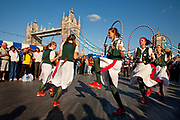 Thames Festival 2009. Women clog dancers performing in front of Tower Bridge.