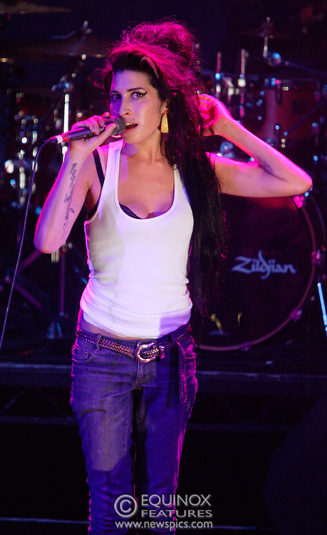 Singer Amy Winehouse, DOB=14/09/1983, performing for her gay fans at the G-A-Y Club. G-A-Y is London's biggest gay club and is held at the London Astoria nightclub, Soho, London, UK. Amy spent much of the show rubbing her itchy nose. She also seemed to have signs of old scars all down one arm...Picture Data:.Photographer: Edward Hirst.Copyright: ©2007 Licensed to Equinox News Pictures +448700 780000.Contact: Equinox Features.Date Taken: 20070415.Time Taken: 014830+0000.www.newspics.com